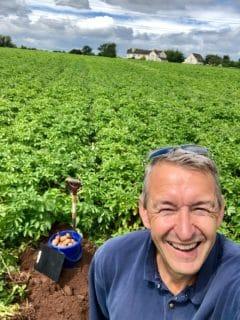 Jeff Goulding in a potato field