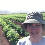 Deb Hart in a Hawaiin potato field